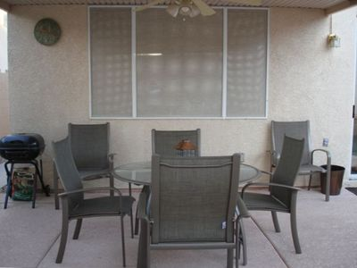 Covered Patio w/Roll Down Shades and Overhead Fan