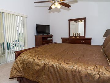 Master bedroom with doors leading onto lanai