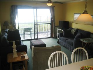 Surfside Beach condo photo - Cosy seating for everyone with flat screen television for end of day relaxing