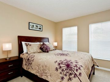 2nd queen bedroom; has a closet with built-in drawers as well as hanging racks