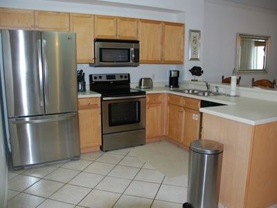 Kitchen  with stainless steel appliances with view of the Gulf.