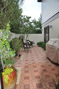 Serene side courtyard off downstairs bedroom.  Gas Grill.