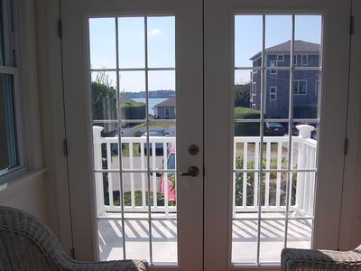 view of Cliff Walk and 1st Beach from sun room leading out to front porch