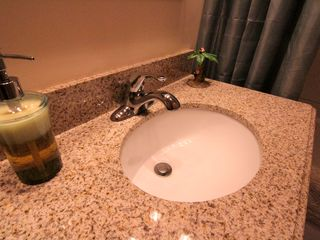 Windham cabin photo - Bathroom sink with granite top soaps & shampoo & hair dryer provided