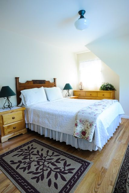 Second floor bedroom with queen bed.