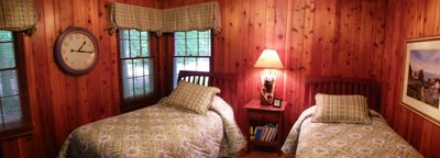 Woods side bedroom with twin beds