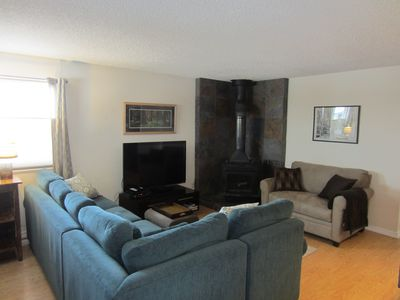 Comfortable living room with large flat screen and ample seating
