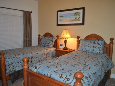 Twin beds with flat screen television.