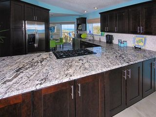 Ponte Vedra Beach house photo - Kitchen has room for several cooks; breakfast area, access to deck and ocean!