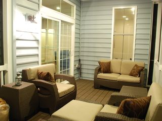 Rehoboth Beach house photo - Outdoor living with enclosed porch.