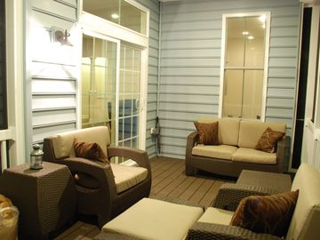 Outdoor living with enclosed porch.