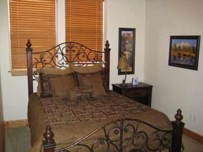 Queen Size Bed in downstairs guest bedroom