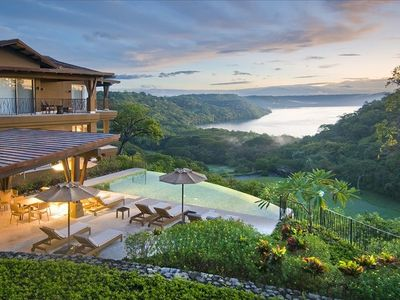 Exterior overview with its infinity edge pool & covered grill/bar/dining center.