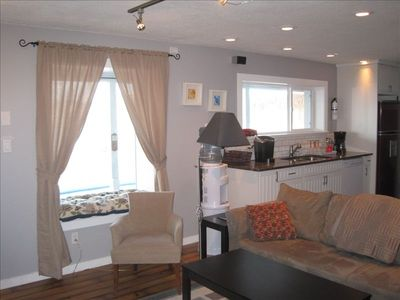 Okanagan Centre house rental - Kitchen and lounge area with large picture window and seat overlooking pool