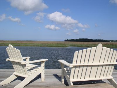 Watch the Dolphins, Pelicans, Blue Herons and other wildlife as you Relax!!