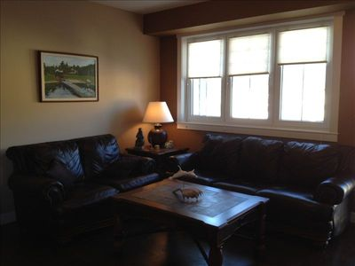 Leather furniture and flatscreen TV in the living room area.