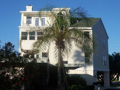 Four story home, 3 car garage, steps to the pristine white sandy Gulf.