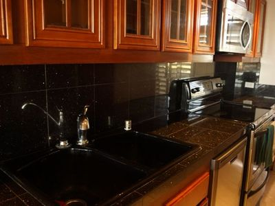 Gorgeous kitchen with granite countertops and stainless steel appliances