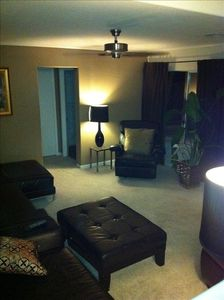 Spacious den with comfortable leather couches and LED TV!