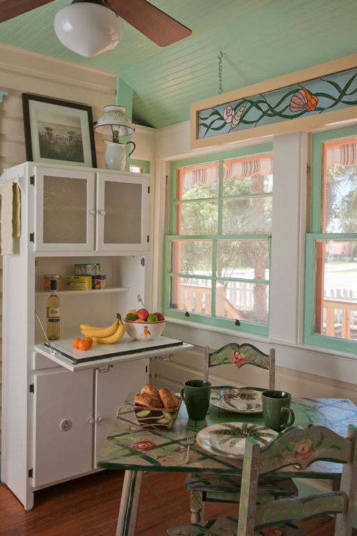 Dining room with cottage style furnishings, hoosier cabinet, lots of storage