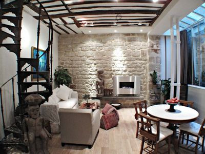 A stunning architectural gem in the Marais, eco-friendly fireplace,