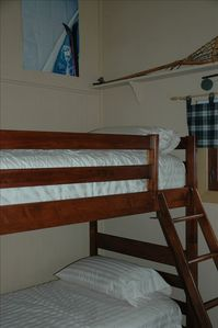 Bunk Beds! There is an additional twin size trundle bed under the bottom bunk.