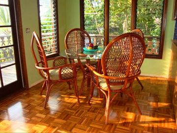 Parquet flooring and French doors lead to oceanfront lanai! Eat inside or out.