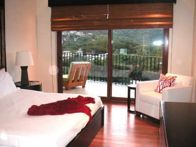 king size bedroom and balcony access