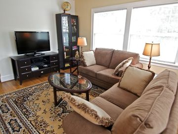 Portland apartment rental - Living room with 42' LCD HDTV, bookcase