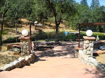 The pond is perfect for a picnic complete w/ gas BBQ, shower, stereo, waterfall