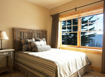 Bright guest bedroom queen, reclaimed snow fence wood headboard & night stand