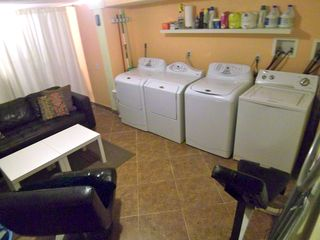 St Petersburg apartment photo - Nice Laundry with ironing boards, soap, & sofa.
