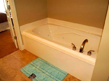 Enjoy the jetted tub in the master suite after a day of shopping or golf.