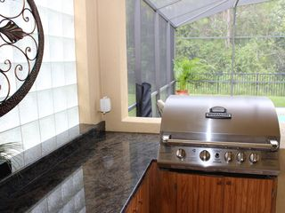 Bellavida Resort house photo - Outdoor living at its finest. Granite Countertop, Gas Binkmann Stainless BBQ