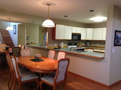 The open floor plan downstairs makes the kitchen and dining areas perfect for entertaining