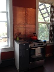 Brooklyn apartment photo - Warmth in Kitchen accented with copper back splash.