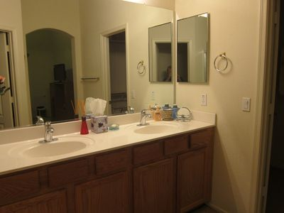 Master bath with large walk-in closet, jacuzzi tub shower and private commode.