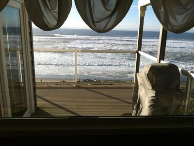 View of the deck and ocean from the dining room.