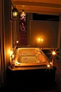 Romantic, candlelit soaking tub for two!