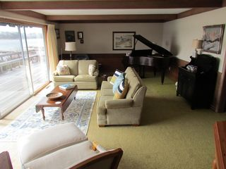 Pocasset house photo - Living room seating facing deck and harbor, baby grand piano and reading corner