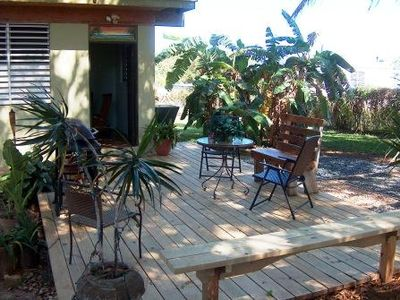 Large deck; seating, grill, shade tree & tropical breezes next to banana tree