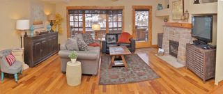Steamboat Springs townhome photo - Spacious Living Room & Balcony with Gas Grill