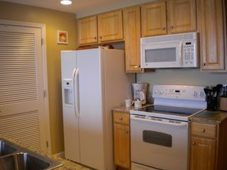 Splash Resort condo photo - Modern appliances and a fully equipped kitchen