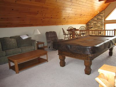 Loft with pool table, trundle beds and sectional sleeper. Game table too.