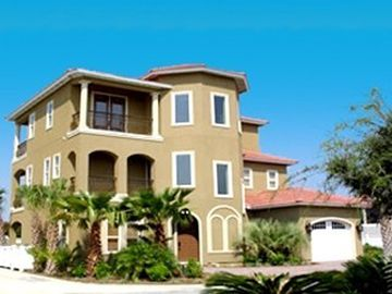 Destin house rental - View of front of house from the green space in cul-de-sac