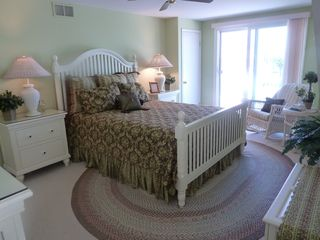 Avalon cottage photo - Second floor master bedroom; queen bed and private deck with park and bay views