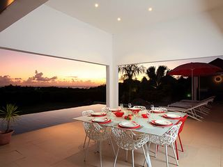 Terres Basses villa photo - dinning table, pool and view
