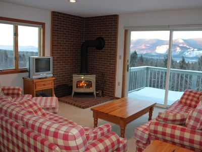 Panoramic views above the treetops and cozy wood stove