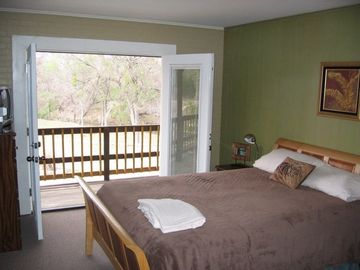 Four of the five bedrooms have pool & creek views.