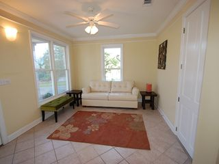 Fort Morgan property rental photo - This charming sitting area doubles as a sleeping area with a Queen sleeper!